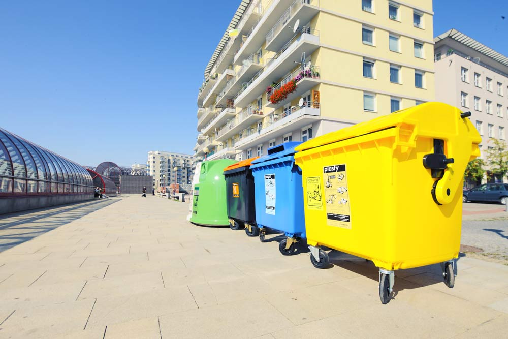 recycling collection bins outside a residential block